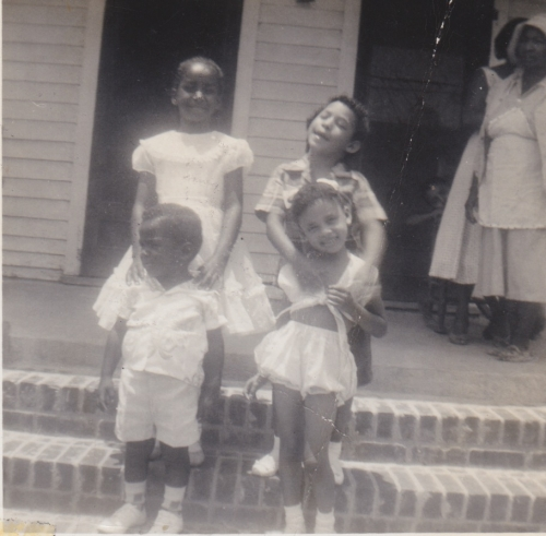 Faye and Wayne Fairfax and Pamela and Sandra Johnston, visiting their grandparents Paul James Sr. and Azelia Bellard Jam